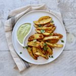 Roasted curry potato wedges with cilantro lime dipping sauce